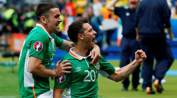 Wes Hoolahan (R) celebrates with his team mate Robbie Brady (L) after firing Ireland into the lead at the Stade de France. REUTERS/Darren Staples