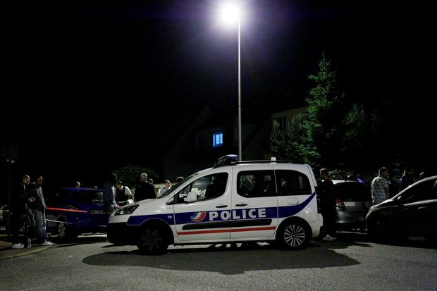 A Police vehicle blocks the road during an assault in Magnanville, 45 kms west of Paris. A man was shot dead during a dramatic police operation in the Paris suburbs late Monday, hours after he had stabbed a police officer to death. Getty Images