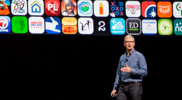 Tim Cook: CEO says that it is 'a huge moment' for Apple. (Photo by Andrew Burton/Getty Images)