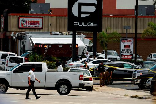 Police continue to investigate a shooting at the Pulse night club following an early morning shooting attack in Orlando, Florida, U.S June 12, 2016. REUTERS/Steve Nesius