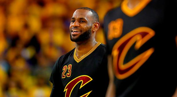 LeBron James #23 of the Cleveland Cavaliers smiles during the fourth quarter against the Golden State Warriors in Game 5 of the 2016 NBA Finals at ORACLE Arena in Oakland, California.