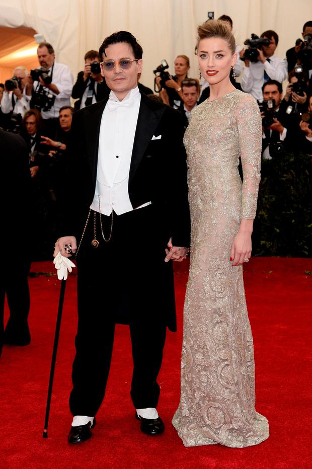 Actors Johnny Depp and Amber Heard attend the