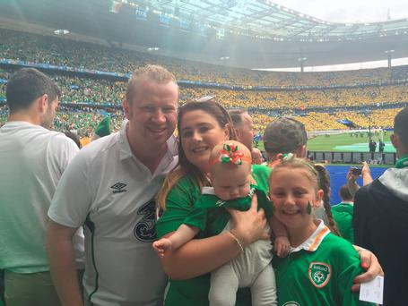 Eoin McCann, his wife Roisín, their baby daughter Aoife and her sister Emma (9) at the Stade de France in Paris