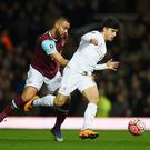 LONDON, ENGLAND - FEBRUARY 09: Joao Carlos Teixeira of Liverpool evades Winston Reid of West Ham United during the Emirates FA Cup Fourth Round Replay match between West Ham United and Liverpool at Boleyn Ground on February 9, 2016 in London, England. (Photo by Mike Hewitt/Getty Images)