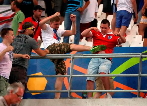 Russia have been handed a suspended disqualification from Euro 2016 over crowd disturbances at the game against England in Marseille on Saturday, UEFA has announced. Nick Potts/PA Wire.
