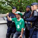 Republic of Ireland supporters pose with police officers outside the stadium ahead of the Euro 2016 group E football match between Republic of Ireland and Sweden in Paris on June 13, 2016. / AFP / PATRICK KOVARIK (Photo credit should read PATRICK KOVARIK/AFP/Getty Images)