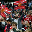 Manchester United fans celebrate their team's victory during the English FA Cup final football match between Crystal Palace and Manchester United at Wembley stadium in London on May 21, 2016. / AFP / Ian Kington / NOT FOR MARKETING OR ADVERTISING USE / RESTRICTED TO EDITORIAL USE (Photo credit should read IAN KINGTON/AFP/Getty Images)