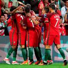 Portugal players celebrate after Nani scored the opening goal