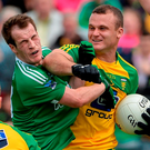 Neil McGee of Donegal strikes out at Ruairi Corrigan. Photo by Oliver McVeigh/Sportsfile