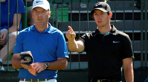 Rory McIlroy (right) talks to caddie J.P. Fitzgerald (left) on the 16th tee
