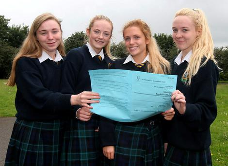 From left: Tara Brazil, Aoife Quinn, Paige Luby and Katie Brazil check over the Irish Leaving Cert Ordinary Level Paper at Coláiste Bríde in Clondalkin, Dublin. Photo: Damien Eagers