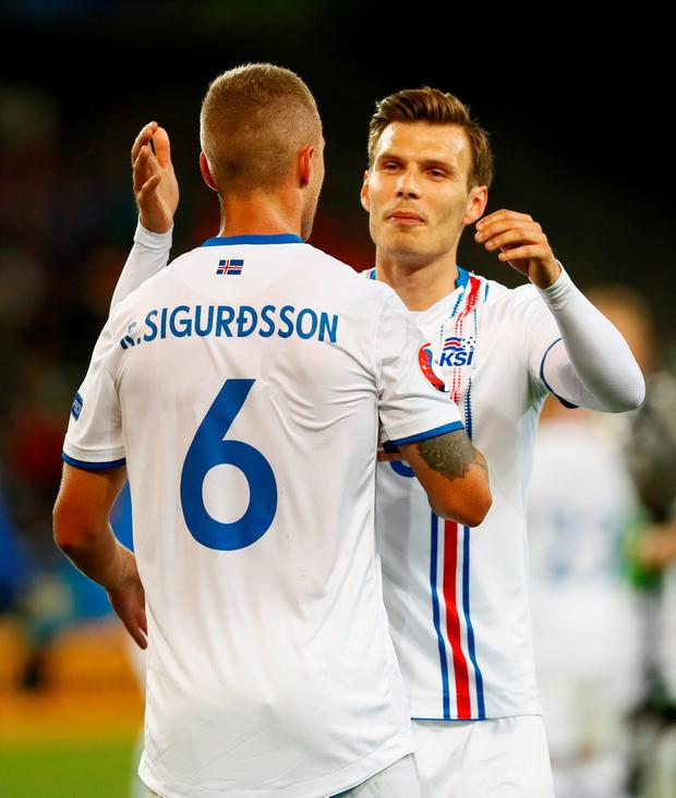 Iceland's Ragnar Sigurdsson and Elmar Bjarnason celebrate at the end of the game