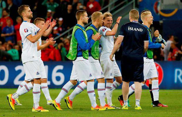 Iceland players celebrate at the end of the match