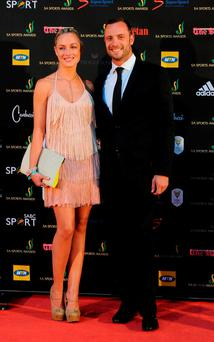 Oscar Pistorius (right) with Reeva Steenkamp in 2012. Photo: Frennie Shivambu/Reuters.
