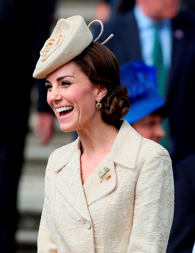 The Duchess of Cambridge speaks to guests during the Secretary of State for Northern Ireland Theresa Villiers' Garden Party at the royal residence at Hillsborough Castle, Co Down