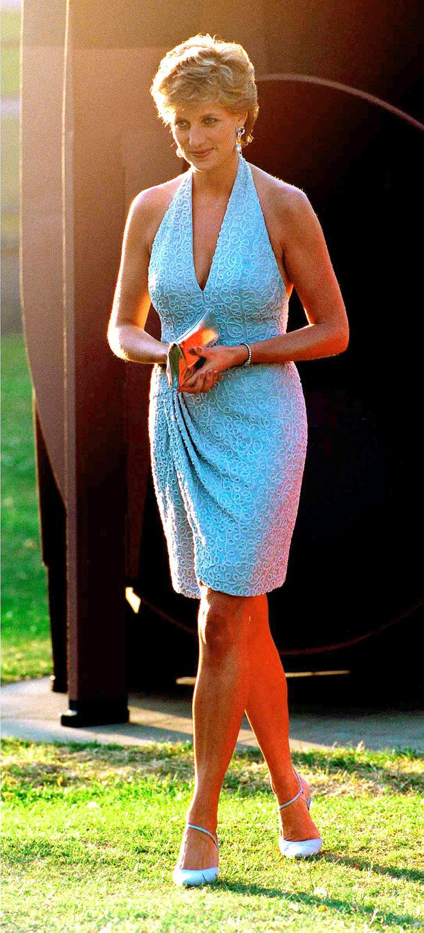 Princess Diana arrives at the Serpentine Gallery, London, June 1995. She is wearing a grey, beaded, halter-neck dress by Catherine Walker. (Photo by Jayne Fincher/Getty Images)