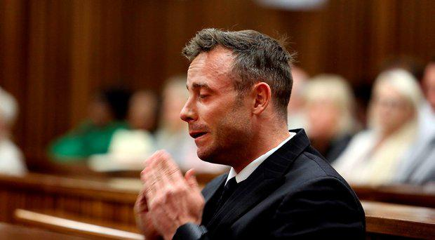 Oscar Pistorius reacts during the third day of his resentencing hearing for the 2013 murder of his girlfriend Reeva Steenkamp, in the North Gauteng High Court in Pretoria, South Africa June 15, 2016