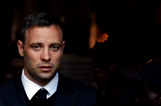 Oscar Pistorius leaves the High Court in Pretoria, South Africa