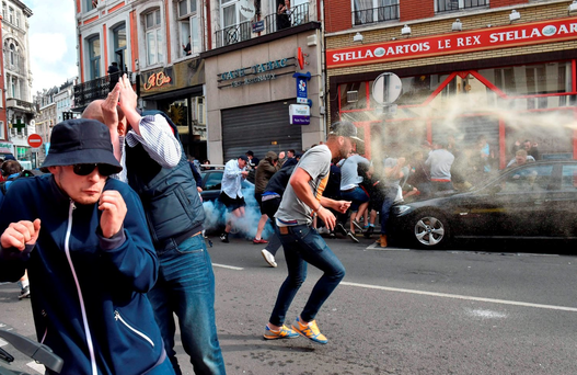 Football fans clash with police officers in central Lille, on June 15, 2016, on the sideline of the Euro 2016 European football championships. / AFP PHOTO / PHILIPPE HUGUENPHILIPPE HUGUEN/AFP/Getty Images