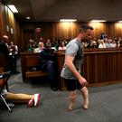 Oscar Pistorius walks across the courtroom without his prosthetic legs during the third day of his resentencing hearing. Photo: Reuters
