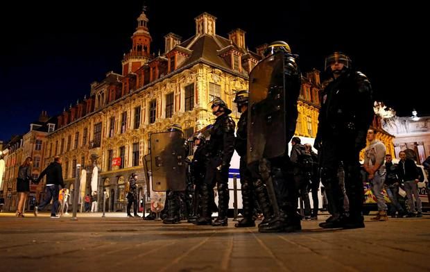 Riot police take up position in Lille. REUTERS/Gnzalo Fuentes