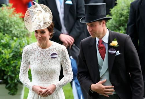Britain's Prince William, Duke of Cambridge, (R) and Britain's Catherine, Duchess of Cambridge, (L) attend the second day of the Royal Ascot