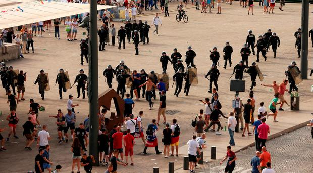 French riot police move in to arrest Russian fans after violence broke out between supporters ahead of the England vs Russia France