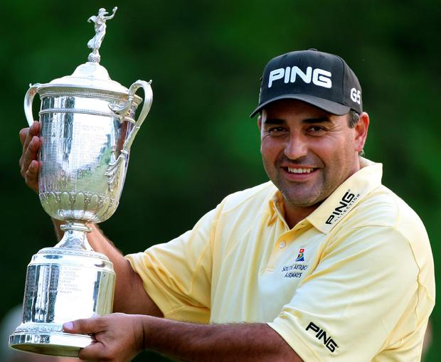 Angel Cabrera of Argentina holds the trophy Oakmont Country Club on June 17, 2007