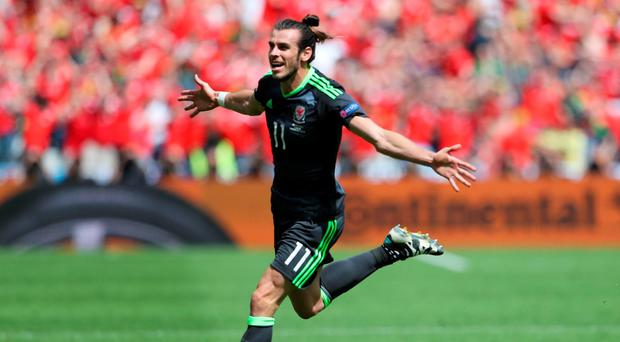 Wales' Gareth Bale celebrates after scoring their first goal REUTERS/Lee Smith