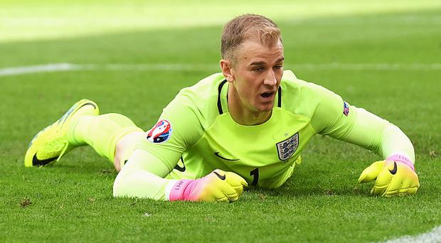LENS, FRANCE - JUNE 16: Joe Hart of England dejected on the floor after conceding Wales first goal during the UEFA EURO 2016 Group B match between England and Wales at Stade Bollaert-Delelis on June 16, 2016 in Lens, France. (Photo by Matthias Hangst/Getty Images)
