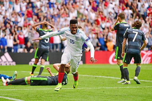 LENS, FRANCE - JUNE 16: Daniel Sturridge of England celebrates scoring his team's second goal during the UEFA EURO 2016 Group B match between England and Wales at Stade Bollaert-Delelis on June 16, 2016 in Lens, France. (Photo by Dan Mullan/Getty Images)