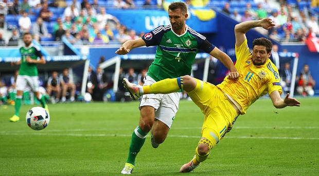 LYON, FRANCE - JUNE 16: Gareth McAuley of Northern Ireland and Yevhen Seleznyov of Ukraine compete for the ball during the UEFA EURO 2016 Group C match between Ukraine and Northern Ireland at Stade des Lumieres on June 16, 2016 in Lyon, France. (Photo by Clive Brunskill/Getty Images)