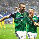 LYON, FRANCE - JUNE 16: Gareth McAuley (L) of Northern Ireland celebrates scoring his team's first goal with his team mate Conor Washington (R) during the UEFA EURO 2016 Group C match between Ukraine and Northern Ireland at Stade des Lumieres on June 16, 2016 in Lyon, France. (Photo by Clive Brunskill/Getty Images)