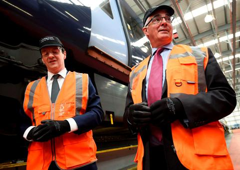 Britain's Chancellor of the Exchequer George Osborne (left) and former Chancellor Alistair Darling attend a pro-Remain event together at the Hitachi Rail Europe plant in Ashford, Kent – but the idea that the UK can reform the EU 'from within' is nonsense. Getty Images