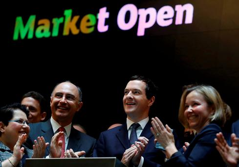 Britain's Chancellor of the Exchequer George Osborne (C) joins Xavier Rolet, CEO of the London Stock Exchange as he attends the inauguration of the ceremonial market opening in London. Photo: Reuters