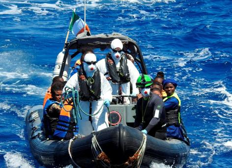 Irish sailors found the bodies of two women during the rescue of more than 100 migrants from a rubber boat in the Mediterranean Sea. Stock image