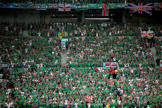 A Northern Ireland fan collapsed and died during last night's international Euro 2016 match at the Stade de Lyon in France. Photo: Nick Potts/PA Wire