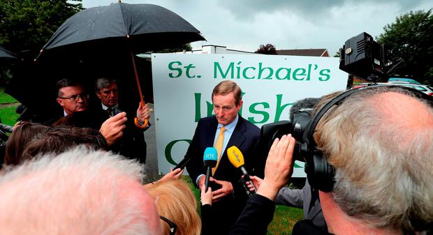 Taoiseach Enda Kenny yesterday suspended his campaign to encourage the estimated 60,000 Irish people living in the UK to vote in the referendum following the news of Cox's death. Peter Byrne/PA Wire