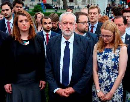 Labour Party leader Jeremy Corbyn (centre) stands during an impromptu vigil at Parliament Square opposite the Palace of Westminster, central London, following the death of Labour MP Jo Cox. Philip Toscano/PA Wire