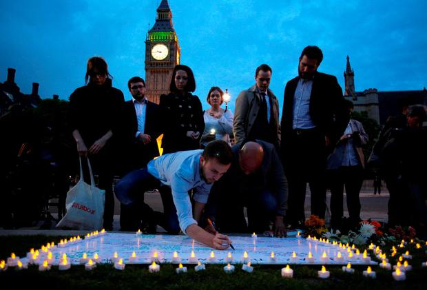 Members of the public sign a white board of condolences at a vigil to slain Labour MP Jo Cox Getty Images