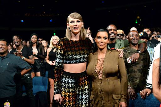 Taylor Swift and Kim Kardashian West attend the 2015 MTV Video Music Awards at Microsoft Theater on August 30, 2015 in Los Angeles, California. (Photo by Kevin Mazur/MTV1415/WireImage)