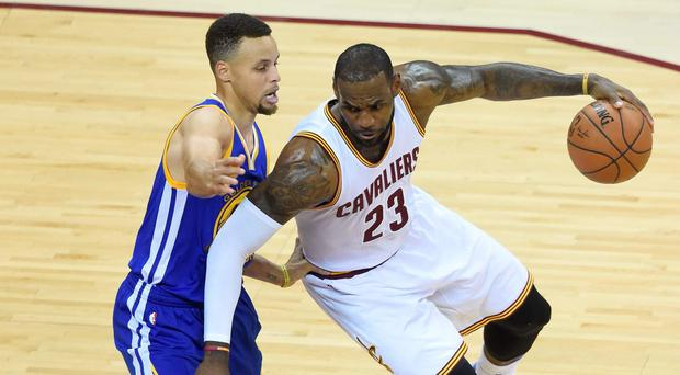 Cleveland Cavaliers forward LeBron James (23) dribbles the ball as Golden State Warriors guard Stephen Curry (30) defends during the first quarter in game six of the NBA Finals at Quicken Loans Arena. David Richard-USA TODAY Sports