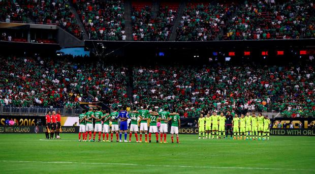 Mexico and Venezuela players pause for a moment of silence in honor of victims in Orlando on Monday