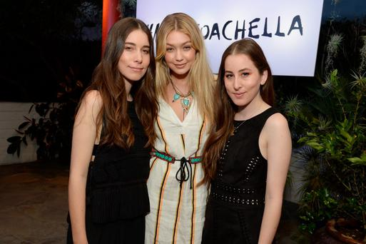 (L-R) Musician Danielle Haim, model Gigi Hadid and Alana Haim attend the Official H&M Loves Coachella Party at the Parker Palm Springs on April 10, 2015 in Palm Springs, California. (Photo by Michael Kovac/Getty Images for H&M)