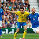 Sweden's Albin Ekdal in action with Italy's Daniele de Rossi