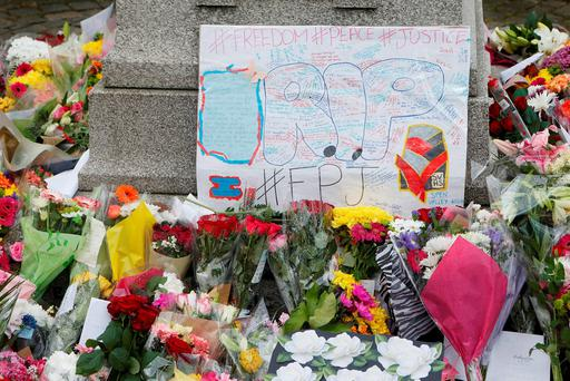 Tributes left to Labour MP Jo Cox who was shot and stabbed to death in the street outside her constituency advice surgery. Danny Lawson/PA Wire