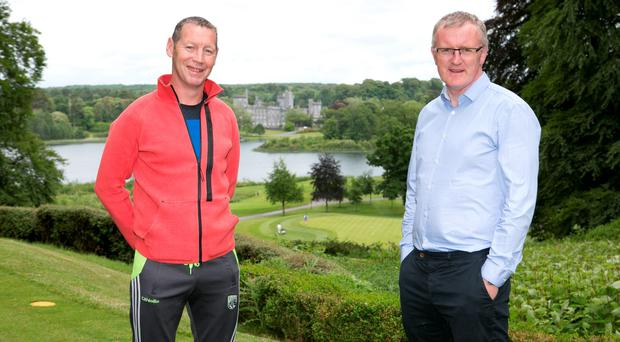 Ciaran Carey and Brian Lohan with Dromoland Castle in the background recalling past 'skirmishes'. Photo: Brian Gavin