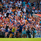 Waterford manager Derek McGrath jumps for joy at the final whistle of their Munster SHC clash against Clare. Photo: Sportsfile