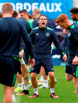 Robbie Brady in good spirits yesterday during the final training session ahead of today's clash with Belgium at the Stade de Bordeaux Picture: PA