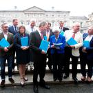 Members of the Housing and Homelessness Committee outside the Dáil yesterday following the publication of their report. Photo: Gareth Chaney/Collins